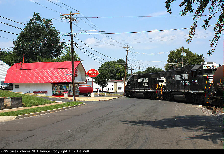 NS 5283, 5290 head back to Morrisville Yard passing the Dairy Queen across Delmorr Ave.